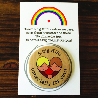 A big HUG 38mm Badge with backing card